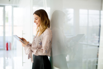Young businesswoman with tablet in office