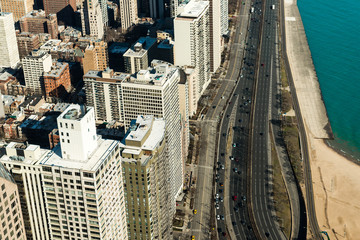 Aerial view of Chicago skyscrapers and highway with traffic close to the Lake Michigan