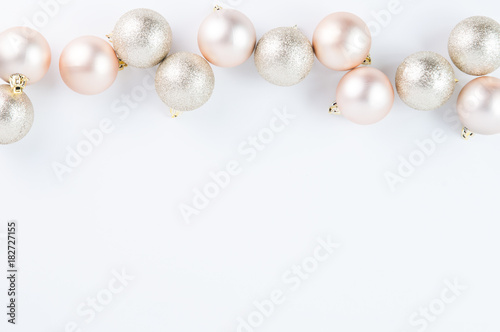 Rose Gold Christmas Decorations On A White Background