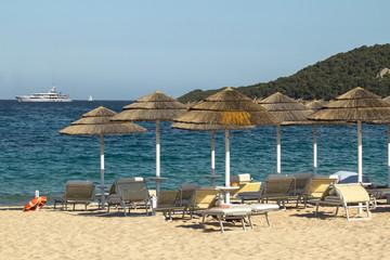 Straw umbrellas on the beach