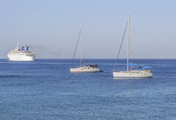 Three boats on the blue clean natural sea for transportation or vacation