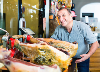 Customer buying iberico or serrano jamon leg