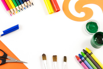 The art concept. The office supplies on the white background with a space on the center of composition