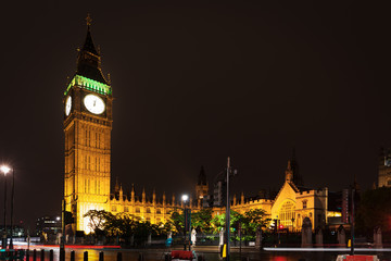 Popular tourist Big Ben and Houses of Parlament in night lights illumination in London, England, UK