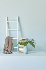 decorative home style vase of flowers white stairs blur room