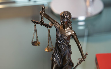 Lady justice in an office of an attorney