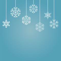 Snowflakes on a blue background. Vector illustration.