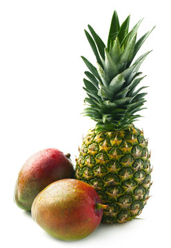 Ripe mango and pineapple on a white  background