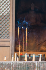 Burning incense in front of Buddha