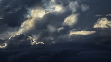 Overcast full moon night sky