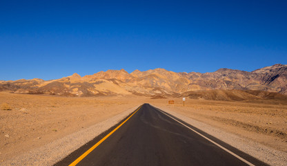Road through the desert of Death Valley in California