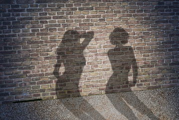 shadow of two prostitutes on the brick wall