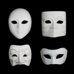 Set of four white venetian carnival masks on black backgound, set 1