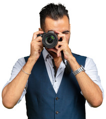 Attractive adult man with a camera isolated on white background