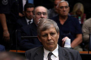 Former Argentine navy officer Astiz and other members of Argentina's Naval Mechanics School attend the sentence hearing of the five-year trial for their role during the 1976-1983 dictatorship in Buenos Aires