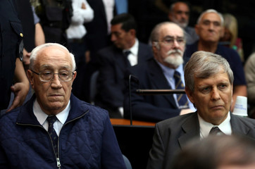 Former Argentine navy officers Acosta and Astiz and other members of Argentina's Naval Mechanics School attend the sentence hearing of the five-year trial for their role during the 1976-1983 dictatorship in Buenos Aires