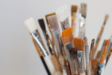 Artist's working brushes. Selective focus.