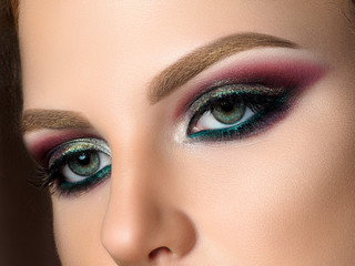 Close up of blue woman eyes with fashion makeup