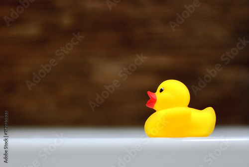 Children\'s rubber ducky in the bathtub. Baby bathing concept.\