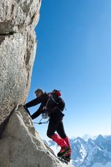 Foto op Aluminium Alpinisme Climbing in Chamonix. Climber on the stone wall of Aiguille du Midi