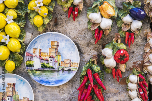 Hand Painted Plate With The Castello Scaligero In Sirmione Italy Hanging On A Wall