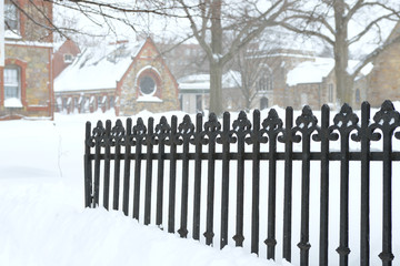 Cast Iron Fence Buried in Snow