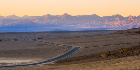 Lonesome street through Death Valley National Park in the evening