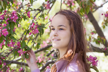 Cute young girl in an apple orchard
