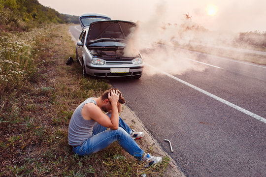 The car broke down, smokes from under the hood, the driver.shocked