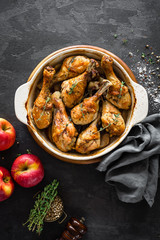Baked chicken legs with apples. top view