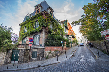 Montmartre streets in Paris, France, Europe. Cozy cityscape of architecture and landmarks. Travel...
