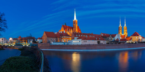 Panorama of Cathedral Island or Ostrow Tumski with Cathedral of St. John and church of the Holy Cross and St. Bartholomew at night in Wroclaw, Poland