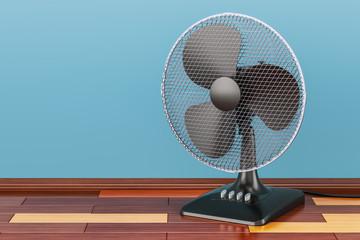 Table fan, on the wooden floor, 3D rendering
