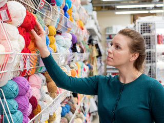 Woman Choosing Yarn for Knitting in Shop for Hobby and Handmade.