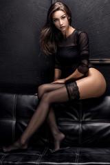 Sensual brunette girl in stockings.