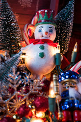Christmas snowman ornament with decorations and lights
