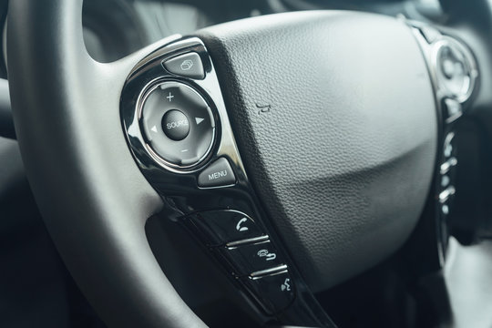 Adaptive cruise control panel buttons and power steering with Paddle Shift on modern car steering wheel, Car interior details