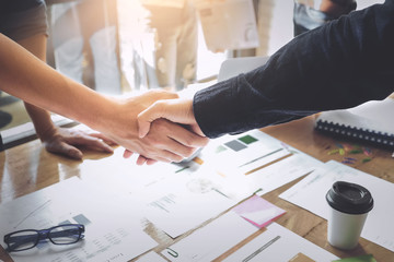 Business Partnership concept. business man shaking hands during a meeting in the office, success, dealing, greeting.