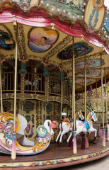Le Carrousel Paul Cezanne in Aix en Provence France with colorful horses, murals and mermaids.