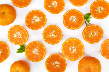 fresh orange with green lea isolate on white background