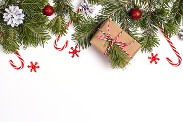 Christmas background with gift box, fir branches and decorations. Space for text.