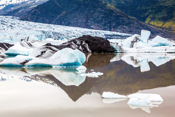 Huge ice floes have broken away from a glacier
