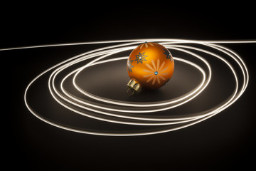 an orange christmas ball with light streaks