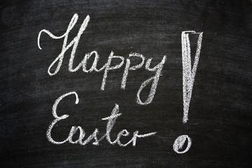 Happy Easter Slogan Written On Black Chalkboard