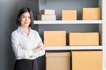 Small business entrepreneur SME, portrait of freelance woman with boxes working at home banner, Young Asian small business owner at office, online marketing packaging and delivery, SME concept