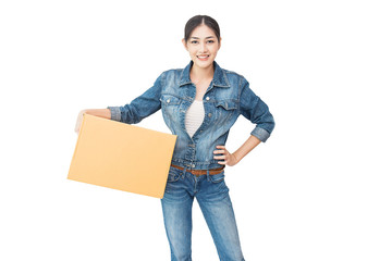 Portrait of happy delivery asian woman wearing jeans her hands holding cardboard box isolated on white background, young asian woman carry brown box moving house delivery service concept