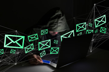Hacker man in the dark using computer to hack data and information system