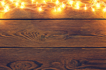 Picture of wooden surface with burning garland on top