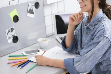 Girl drawing at work
