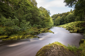 The river Wharfe is high at Bolton Abbey England long exposure